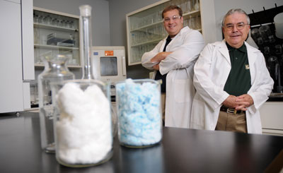 Cotton candy-like glass fibers developed at S&T could speed healing of open wounds, according to Curators' Professor Emeritus Delbert Day (right) and Steve Jung, an S&T graduate and glass scientist at Mo-Sci Corp.