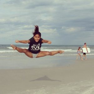 Frances Manahan practices her cheerleading technique over the summer while visiting New Smyrna Beach, Fla. She was one of more than 20 people to take part in the #MinerNation Instagram contest.
