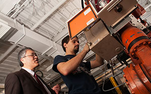 Dr. Frank Liou (left) and Missouri S&T student Cris Abbott demonstrate metal deposition in S&T's Laser Aided Manufacturing Process (LAMP) Laboratory