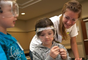 A student works with children at one of Missouri S&T's summer camps.