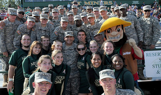 Soldiers from nearby Fort Leonard Wood, Mo., pose with Missouri S&T cheerleaders and mascot Joe Miner during S&T's annual Military Appreciation Day football game.
