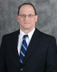 Dr. Mark E. Schlesinger