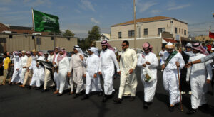 Students representing the Missouri S&T Saudi Student Association walk in the Celebration of Nations parade held annually in September.