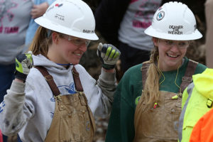 Lindsay Miller (left) reacts to the results of Deanna Fitzergerald's effort in the jackleg drilling event on Friday, April 4.