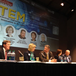 "Chancellor Cheryl B. Schrader chats with fellow panelist Kevin Token of BSA LifeStructures prior to the  ""STEM: Growing Innovation"" forum. With Schrader and Token are, from left, Mike Downing, director of the Missouri Department of Economic Development; Dr. Sharon Frazee of Express Scripts; and Dr. Terry Brewer, founder of Brewer Science."