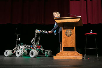 Chancellor Cheryl B. Schrader receives her script from Phoenix, the Mars rover designed by Missouri S&T students, at the beginning of her Fall 2014 State of the University Address.