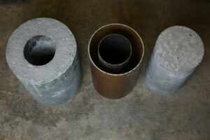 From the left: ElGawady's concrete column, the steel tube and polymer without concrete, and the current standard.