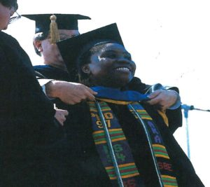 Dr. Tamiko M. Youngblood receives her Ph.D. hood during May 1997 commencement ceremonies.