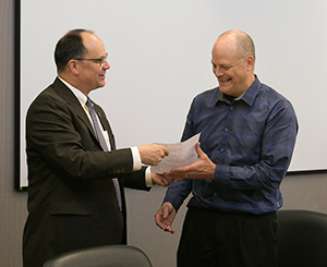 Missouri S&T Provost Robert Marley presented the 2015 UM System President's Award for Service to Dr. Joel Burken.