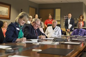 Missouri S&T Chancellor Cheryl B. Schrader and Phelps County Regional Medical Center CEO John Denbo sign a memorandum of understanding on July 2, 2015.