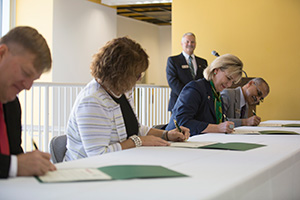 Officials from Missouri S&T and Honeywell Federal Manufacturing & Technologies signed a Master Collaboration Agreement Sept. 15, 2015.