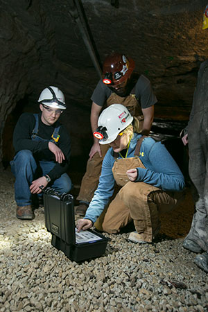 Missouri S&T students use a rotating vane anemometer, provided by Doe Run, in the Missouri S&T Experimental Mine. Shown left to right are: Benjamin Rice, Holden Henry and Katherine Burke. Photo by Sam O'Keefe