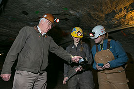 Under the guidance of Dr. Stewart Gillies, Missouri S&T students use a precision air pressure sensor, provided by Doe Run, in the Missouri S&T Experimental Mine. Gilles, left, is pictured with Johanna Jeffryes and Katherine Burke. Photo by Sam O'Keefe/Missouri S&T