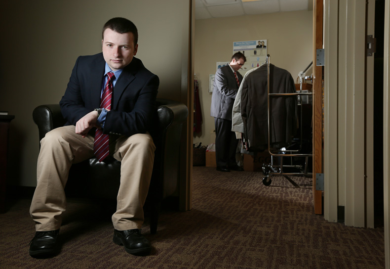 Drew Harden, a junior in computer engineering and computer science, poses in front of career opportunities and employer relations' suit closet, which provides students with appropriate attire for job interviews, networking events and the Missouri S&T Career Fair. Sam O'Keefe/Missouri S&T