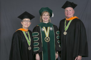 Gail Dolan Hahn (left) and Craig A. Barnes (right) are pictured with Missouri S&T Chancellor Cheryl B. Schrader.