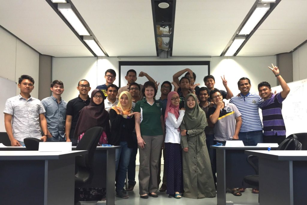 Missouri S&T's Shari Dunn-Norman is surrounded by UTP students in March 2015 in Malaysia. She was a guest lecturer in UTP's drilling program, teaching the production module for three weeks.