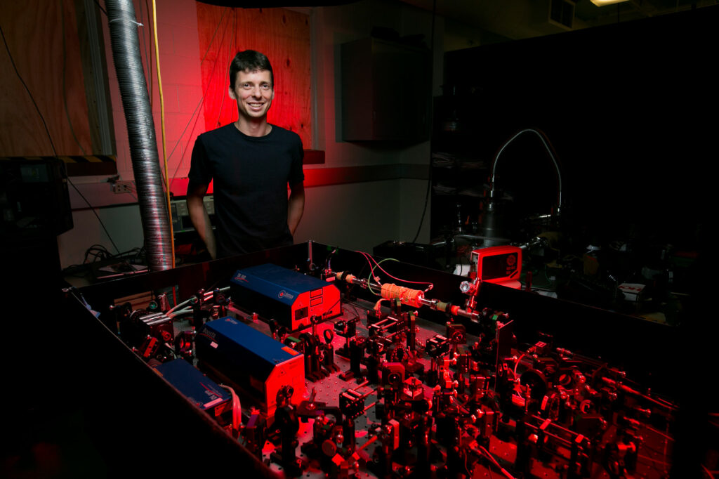 NSF CAREER Award recipient Dr. Daniel Fischer, assistant professor of physics, and his laser research setup. Sam O'Keefe/Missouri S&T