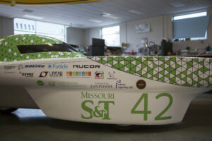The Solar Car Team unpacks the solar panes for the car after the car was returned following the vinyl decals installation.              Photo by Sam O'Keefe/Missouri S&T
