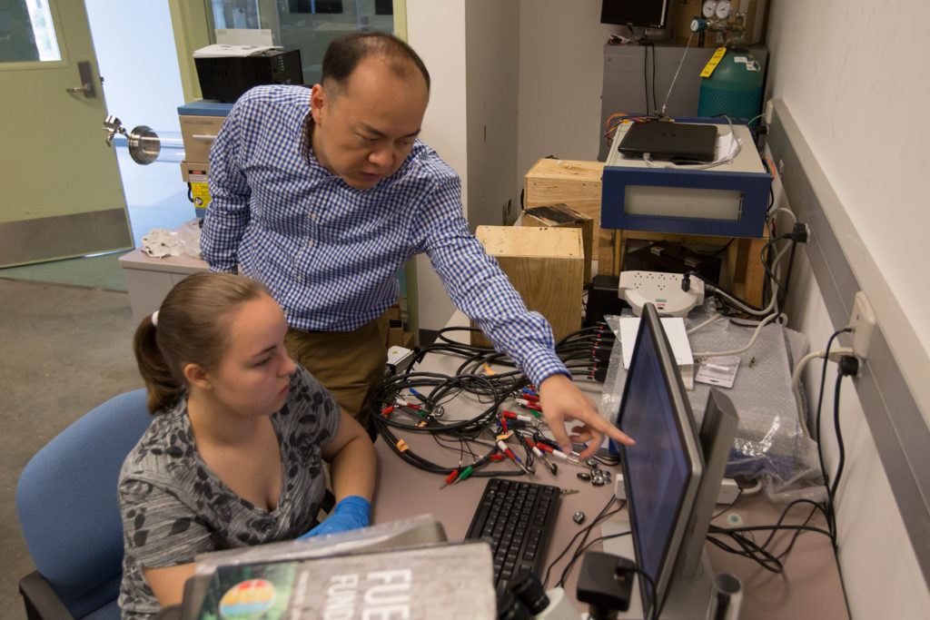 Dr. Jonghyun Park oversees high school students Daniel Yoon and Jessica Slavick during the Summer Research Academy. The project focuses on energy storage as Daniel creates a lithium ion battery. Photo by Sam O'Keefe/Missouri S&T