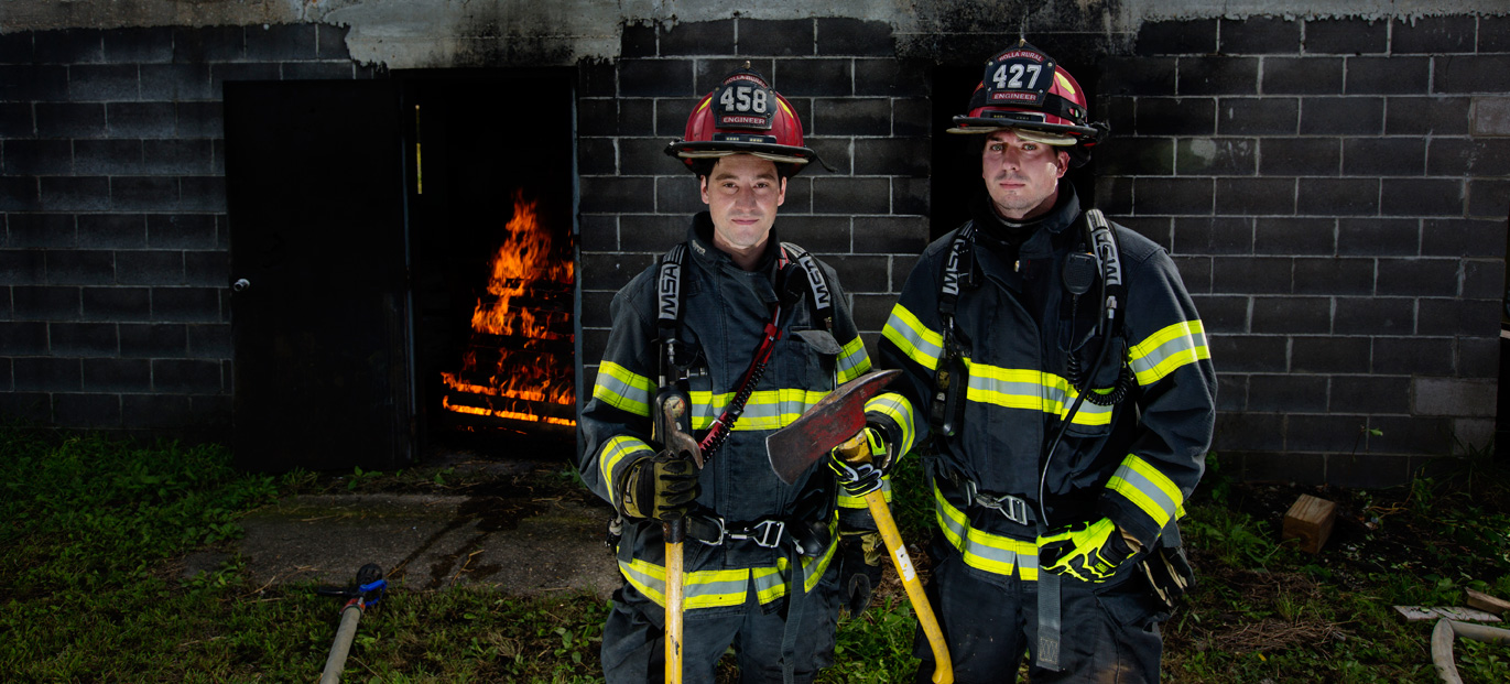 "Alumnus Chris Franklin and senior student James ""Jimmy"" Nash train at the Regional Fire Training Center in Rolla. Franklin volunteered for the Rolla Rural Fire District before taking a job out-of-state, while Nash continues to volunteer for the department. Photo By Sam O'Keefe/Missouri S&T"