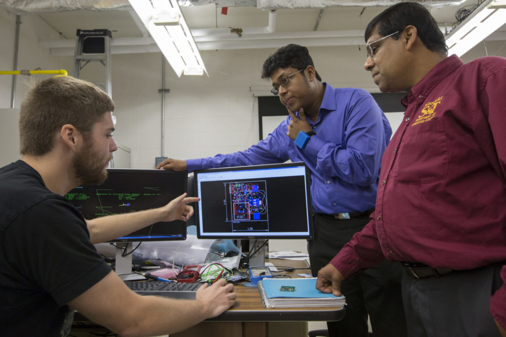 A Missouri S&T team including, from left, graduate student Alec Bayliff, Dr. Debraj De and Dr. Sajal Das, created a wearable device for the wrist that can track a person's movements, environment, bio-signals and more. Photo By Sam O'Keefe/Missouri S&T