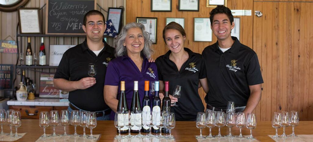 Patrick Martin (from left), Esther Martin, Anna Wallace and Derek Martin pose with Martin Brothers Winery's mead offerings at the meadery's guided tasting bar outside of Hermann, Missouri.