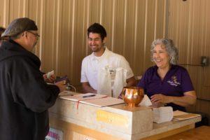 Derek (center) and Esther Martin serve a satisfied customer.