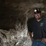 Braden Lusk stands at the entrance of the Missouri S&T Experimental Mine, photo by Sam O'Keefe