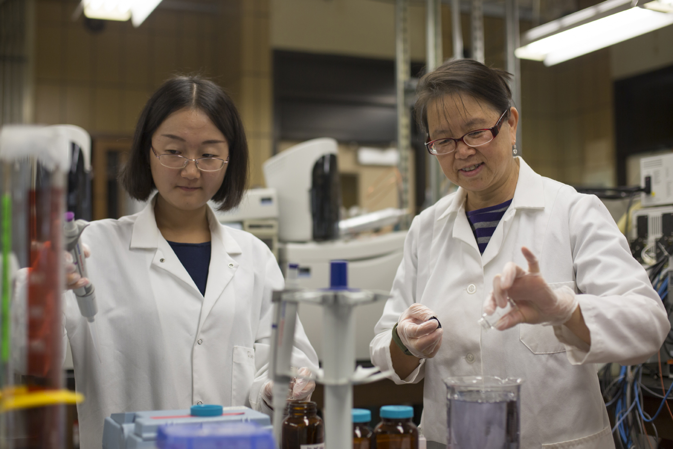 Dr. Honglan Shi and her students Runmiao Xue and Haiting Zhang conduct drinking water quality research in Schrenk Hall.