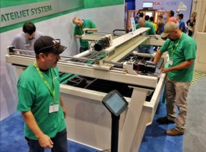 The Missouri S&T Rock Mechanics Explosive Research Center team won a new WARDjet waterjet during a competition in September in Chicago. Wearing green shirts, from left team members Jay Schafler, Marty Langenderfer, John Rueschmann and Jeff Heniff put together a WARDjet to win the competition. It was installed at Missouri S&T on Tuesday, Nov. 1.
