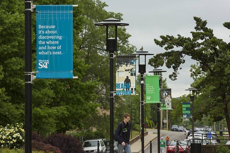 Light pole banner environmental graphics around campus in the Miners Dig Deeper branding. Sam O'Keefe/Missouri S&T