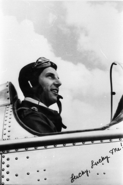 "Lt. George Allison Whiteman poses in the cockpit of his plane, the ""Lucky, Lucky Me!"""