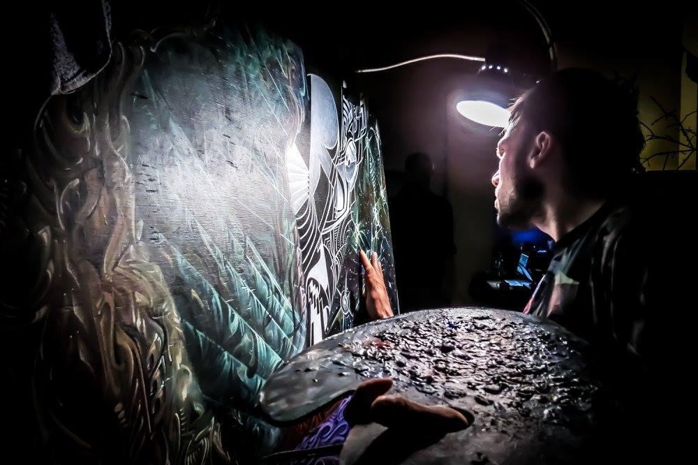 Carpenter paints one of his pieces.