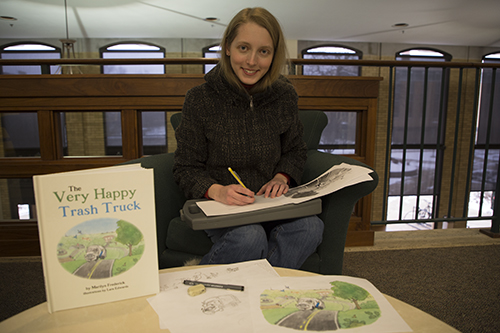 S&T alumna Lara Edwards poses with her first illustrated book. Greg Katski/Missouri S&T