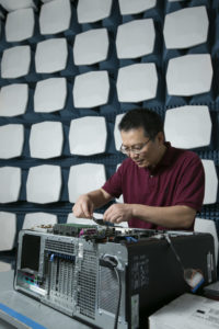 Missouri S&T professor Jun Fan works in the semi-anechoic chamber at the Electromagnetic Compatibility Laboratory. Fan is studying ways to make smartphones faster and more reliable. Sam O'Keefe/Missouri S&T