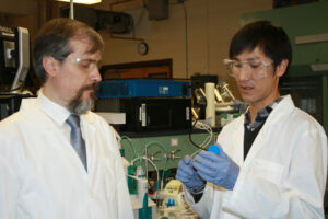 Dr. Vadym Mochalin (left) and visiting researcher Atsushi Kume (DAICEL Corp.) working in the lab.