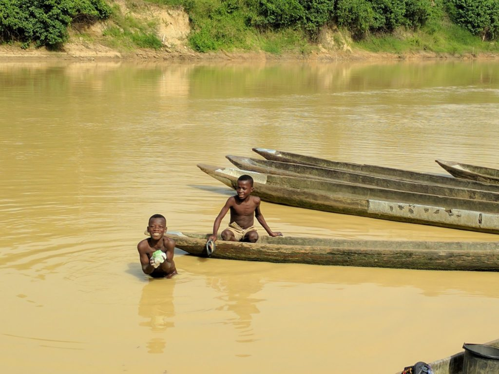 Two boys swim in the Tano River near Ghana's western border with Ivory Coast. Contamination from artisanal mining has rendered the river's water unfit for human consumption. Photo by Kenneth Bansah.