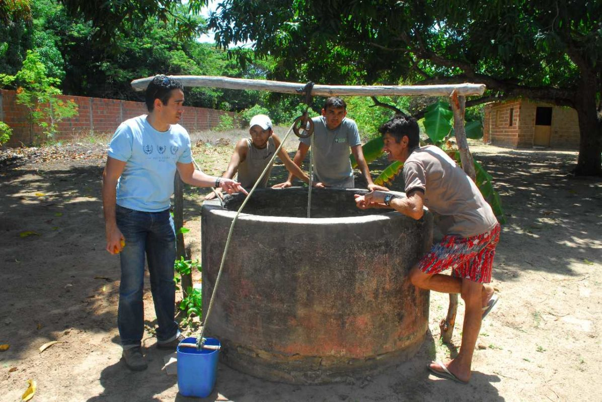 S&T students and faculty work with locals on a water well in Guatemala.