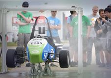 "Missouri S&T's Formula Electric car during the ""rain"" test, which helps ensure the car is save for both the driver and the pit crew in wet weather."