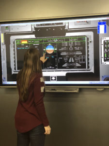 Katie Frogge tests the digital touch screen in the T-X Classroom at Boeing's St. Louis facility. Boeing photo.