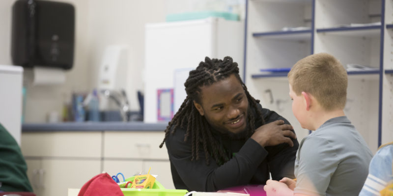 On top of his game, S&T running back also gives back