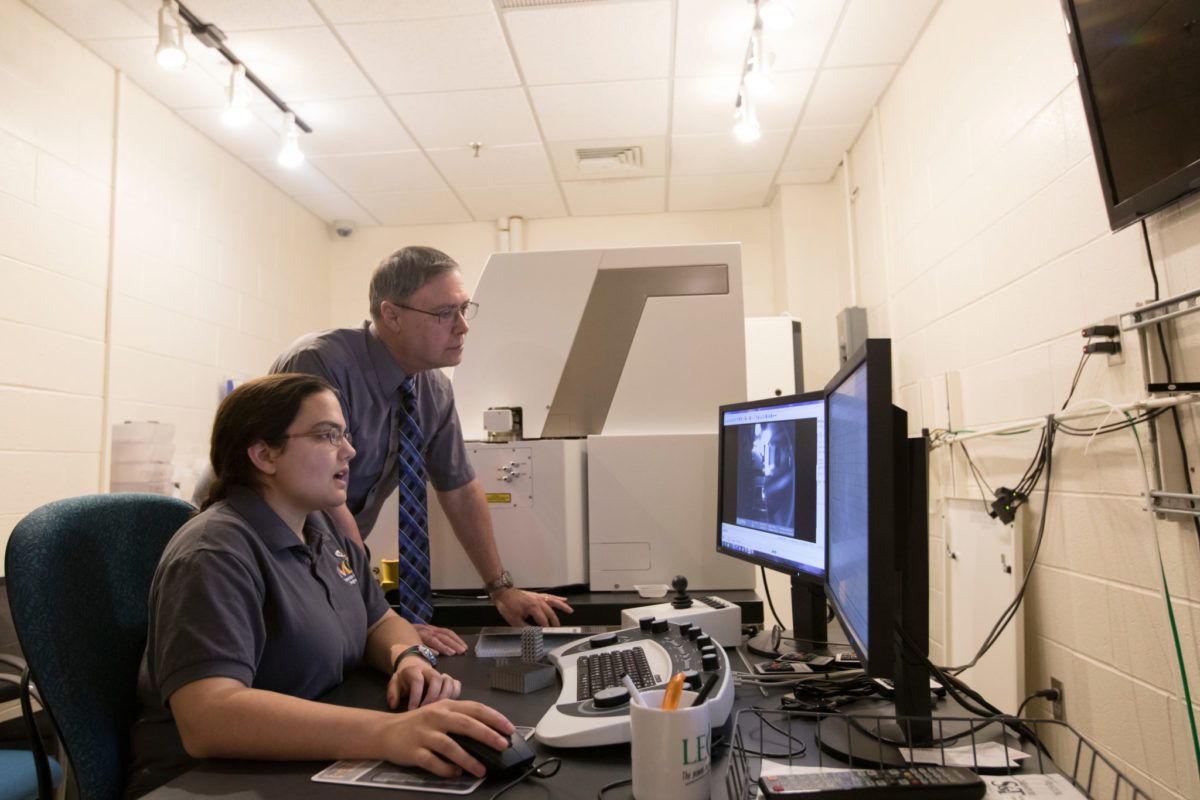 Professor Joseph Newkirk and Myranda Spratt, a Ph.D. student in materials science and engineering, examine images of a stainless steel allow designed to be lighter than conventional alloys. Sam O'Keefe/Missouri S&T