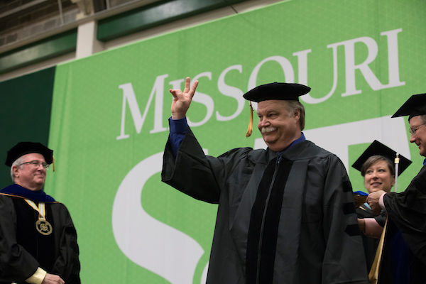 Rock-and-roll grandpa earns doctoral degree for research on using desert shrub as asphalt recycling agent