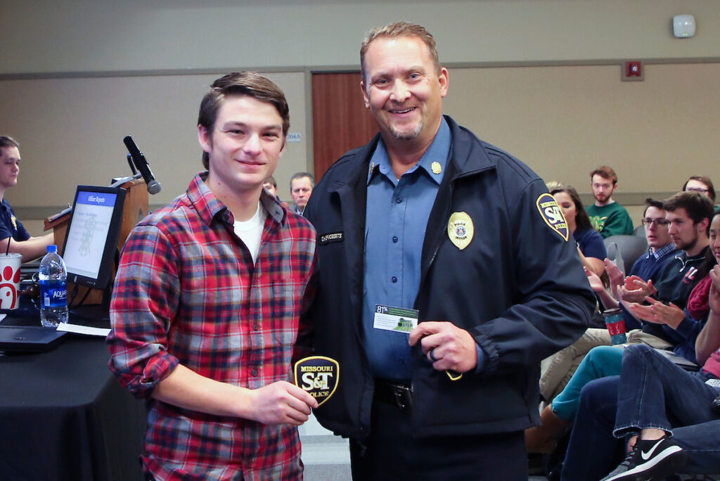S&T University Police Chief Doug Roberts (right) presented S&T student Dalton Gerdes a Step-Up Award for his help in dealing with a stranded motorist.