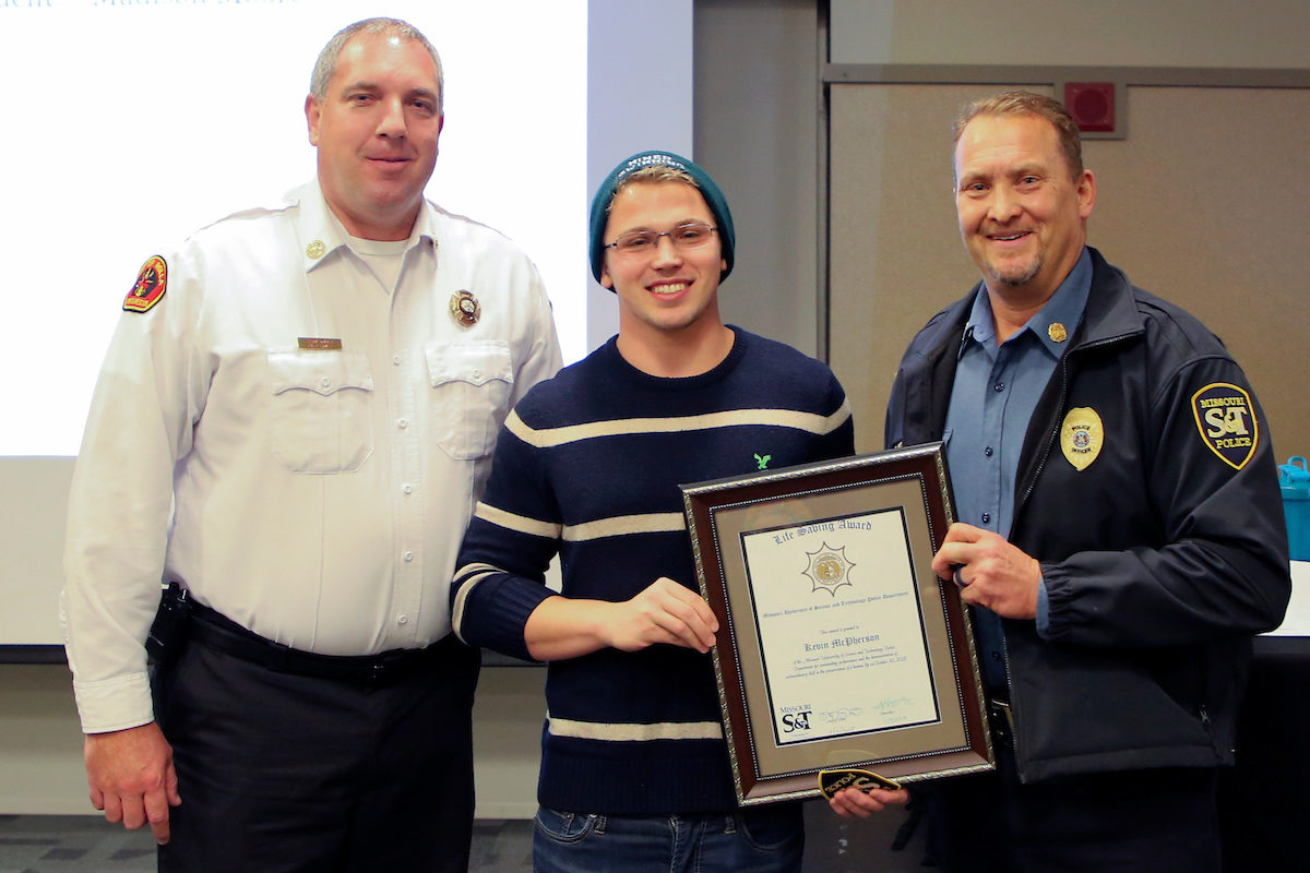 Missouri S&T electrical engineering senior Kevin McPherson (center) was honored by Rolla Fire Chief Ron Smith (left) and S&T Police Chief Doug Roberts for saving a fellow student from drowning.