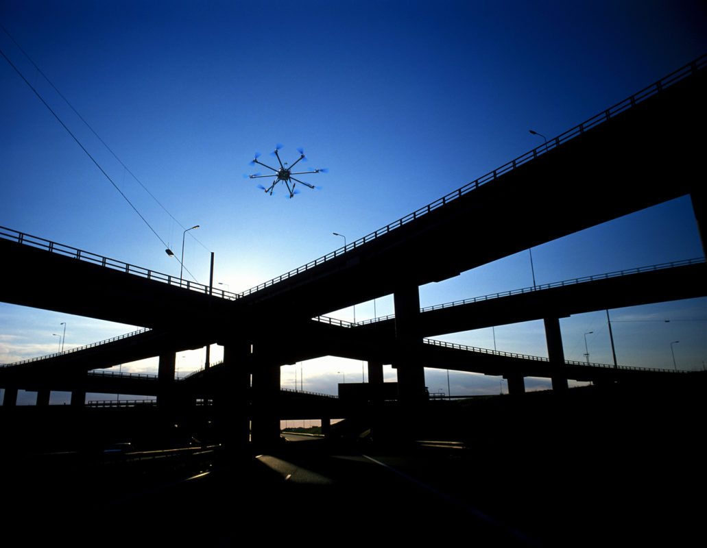 Photo of unmanned aerial vehicle above bridge.