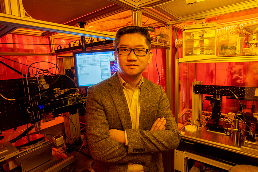 NSF CAREER Award recipient Dr. Heng Pan, assistant professor of mechanical and aerospace engineering, by his nanomanufacturing equipment. Photo by Tom Wagner/Missouri S&T.