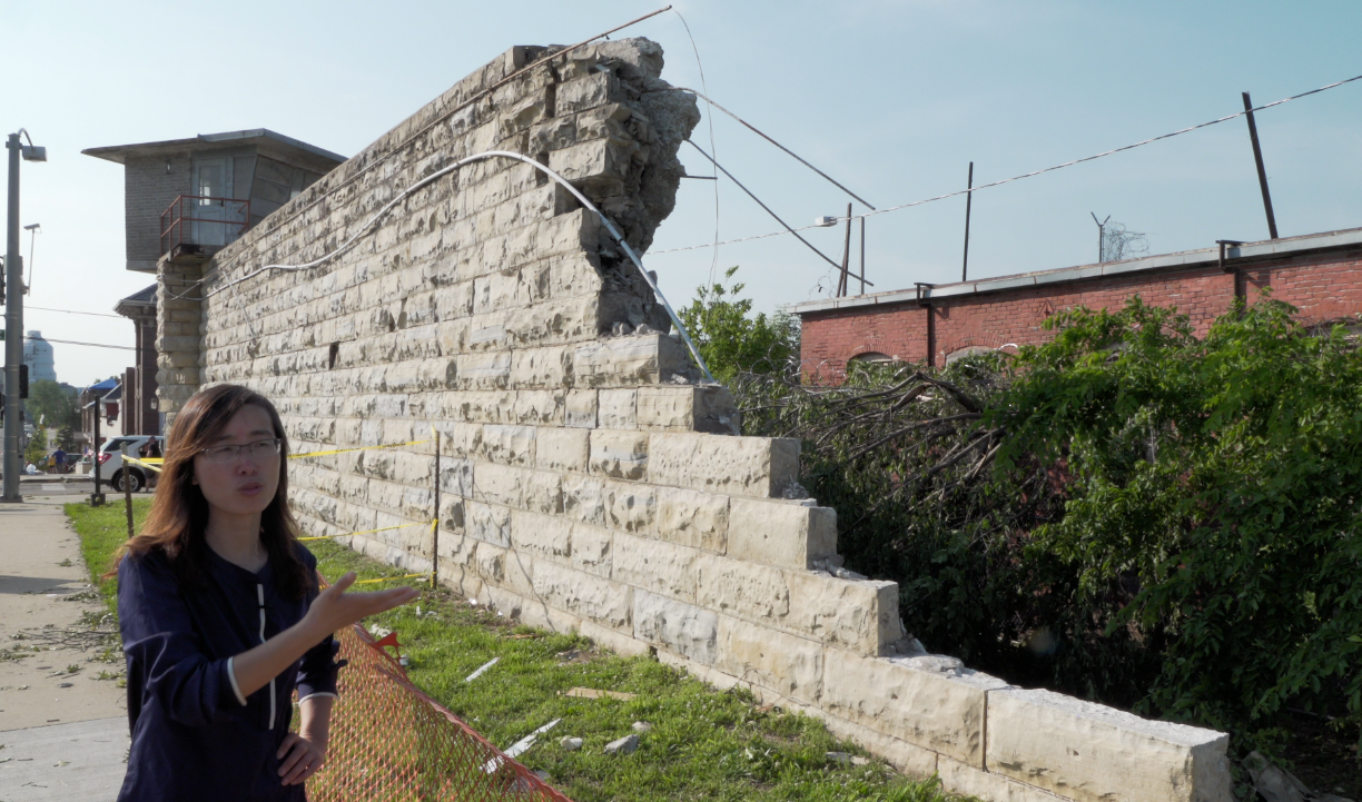 Dr. Guirong (Grace) Yan inspects the wall of the former Missouri State Penitentiary, which was damaged by the tornado that struck Jefferson City, Missouri, on May 22, 2019. Photo by Terry Barner/Missouri S&T.