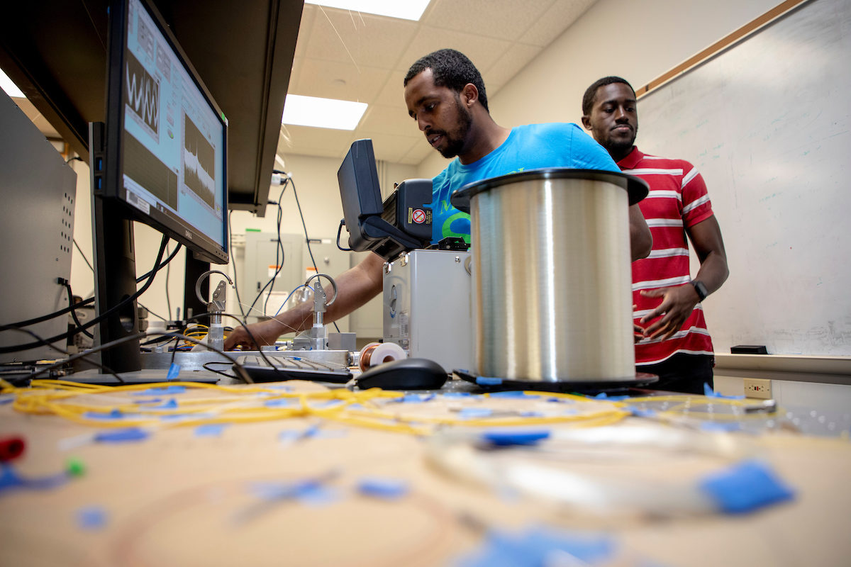Tennessee State University students Ahmed Osmand (foreground) and Sam Wreh were among the students selected for Missouri S&T's Summer Engineering Research Academy. They are shown here working on fiber optic sensors for use in their metallurgical engineering research. Photo by Tom Wagner/Missouri S&T, ©2019 Missouri S&T