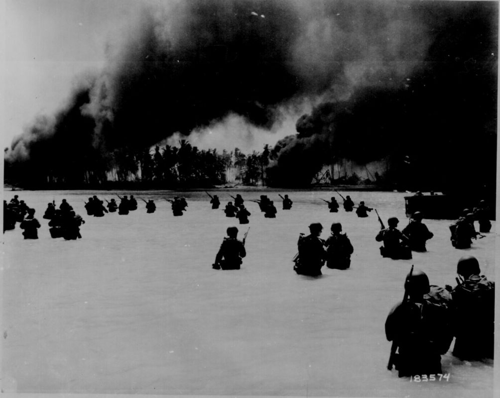 The U.S. Army's 165th Infantry Regiment, 27th Infantry Division, invading Butaritari, the main island of the Makin Atoll in November 1943. National Archives photo.